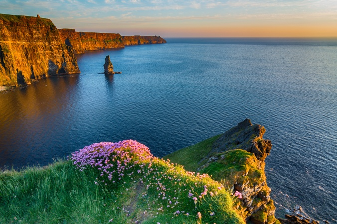 Irish world famous tourist attraction in County Clare. The Cliffs of Moher West coast of Ireland. Epic Irish Landscape and Seascape along the wild atlantic way. Beautiful scenic nature from Ireland.