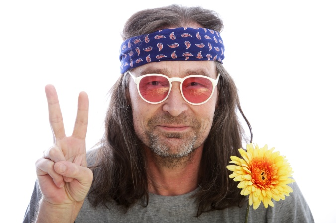 Male hippie making a peace sign